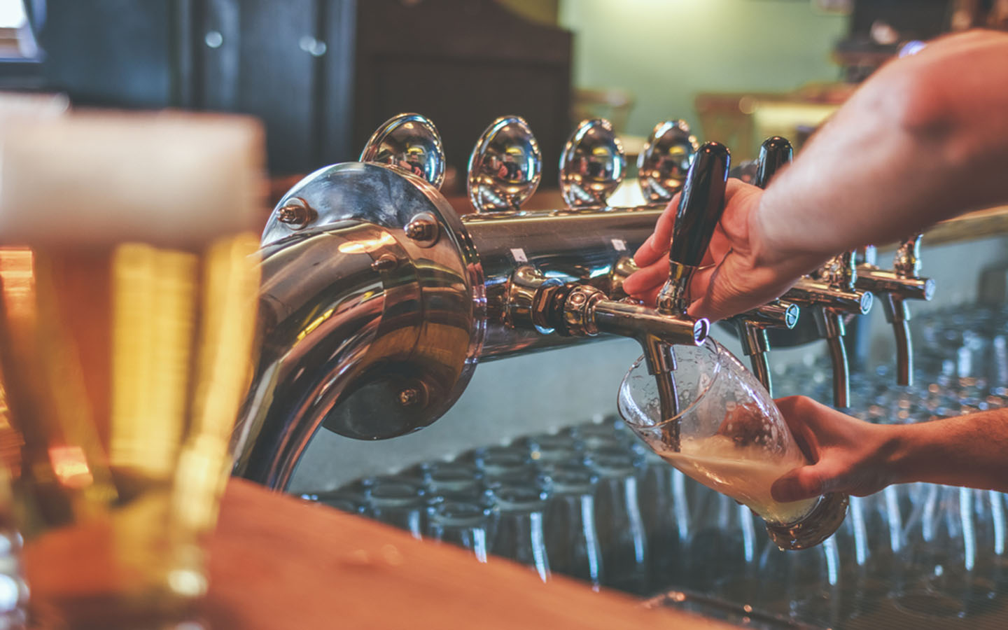 pouring draught beer out of beer tap