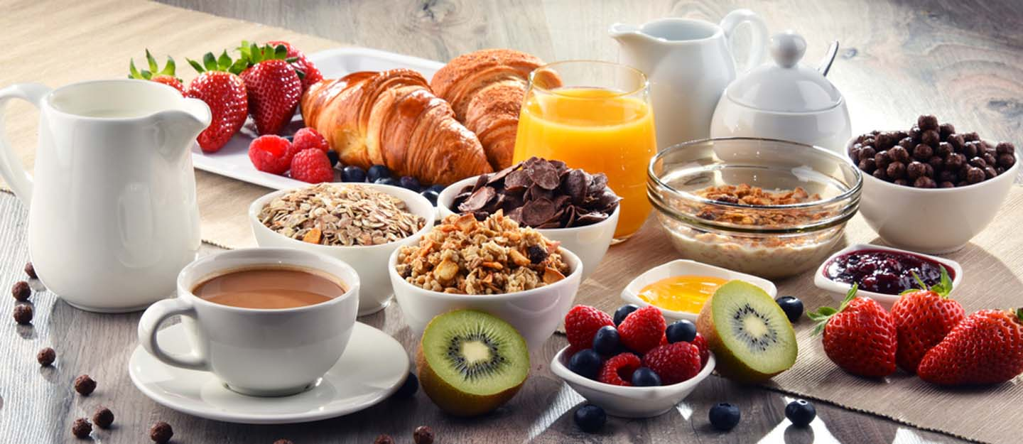 Juice, croissants, tea and other classic breakfast dishes