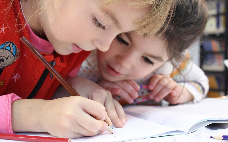 kids doing homework together at a nursery