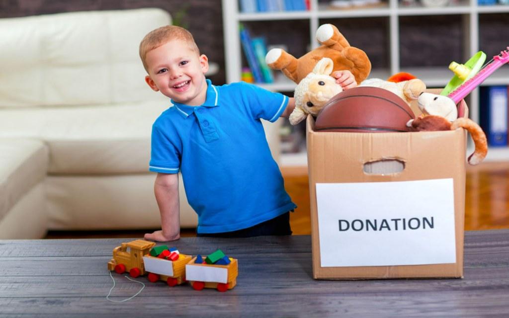 child donating toys