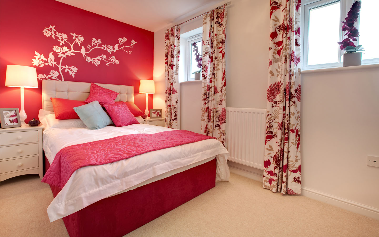 Red coloured bedroom.