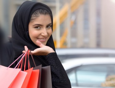 A woman after shopping in the best mall in Sharjah