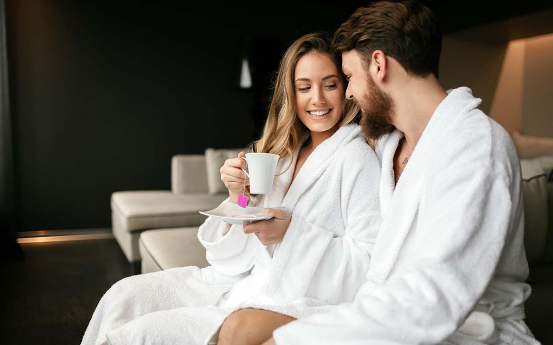 couple enjoying tea at a spa lounge