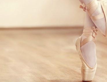 Ballerina feet on wooden floor, ballet centres in Dubai concept