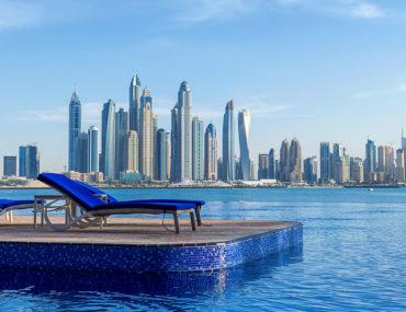 beach chairs at hotel overlooking Dubai Marina