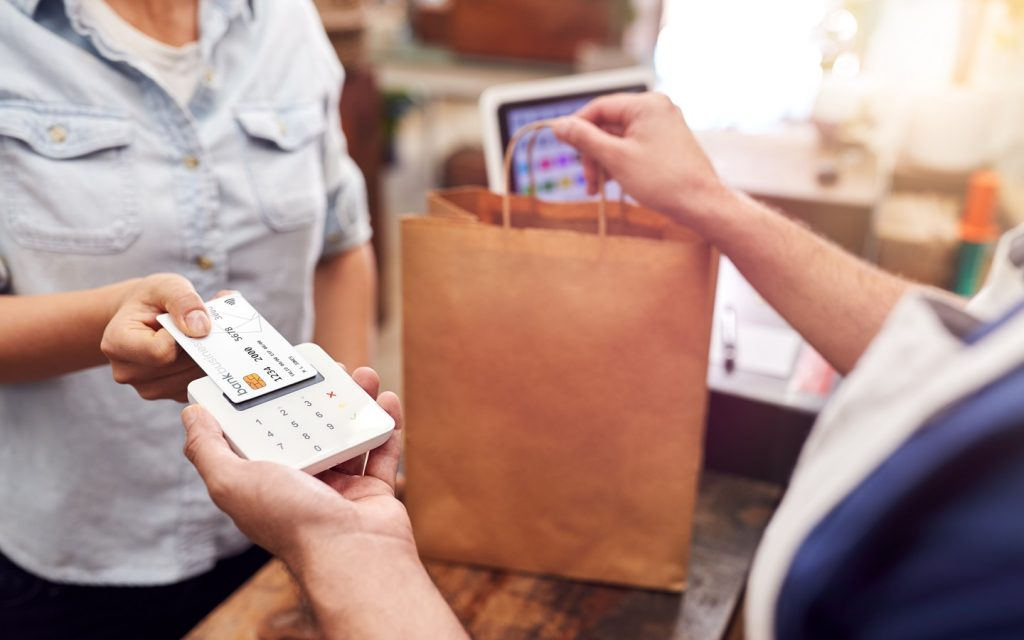 Women paying for shopping using one of the top credit card for expats