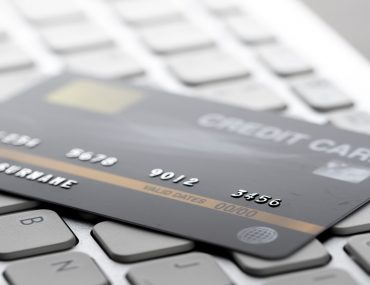 A credit card placed on a key board