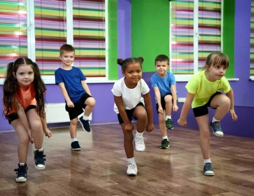 A group of a children practicing for a dance performance