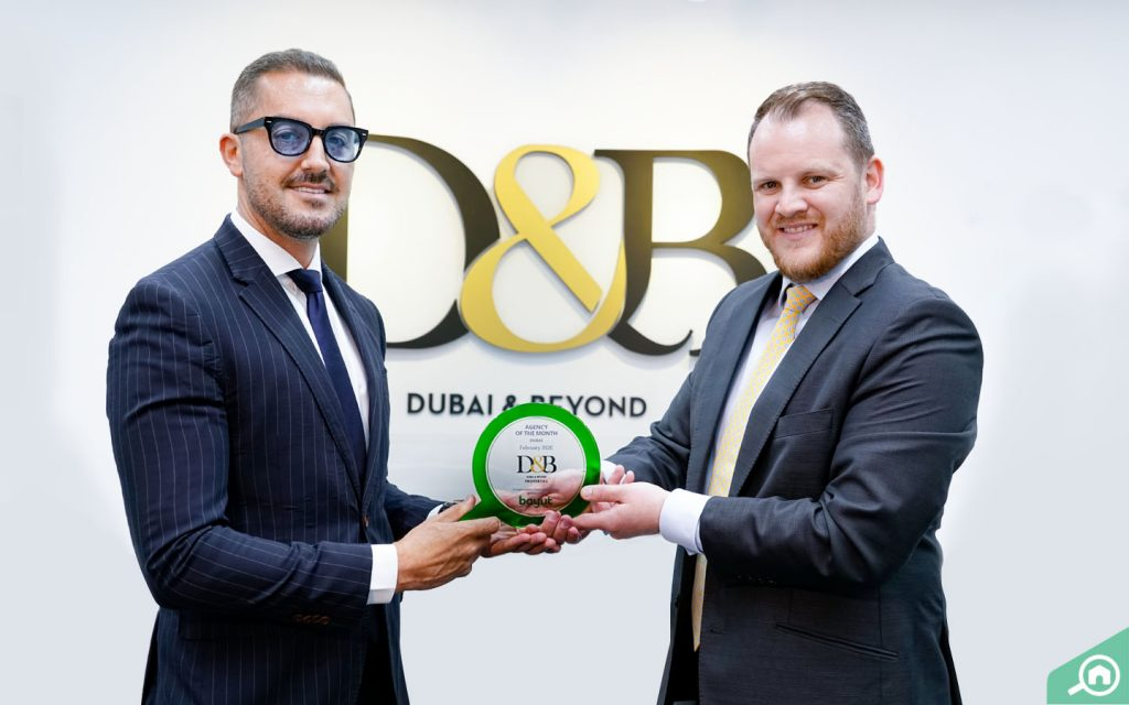 Edward Millward, Director of Sales and Marketing, at D&B Properties in Dubai, receives award from Chris Crawford, Assistant Director of Sales at Bayut