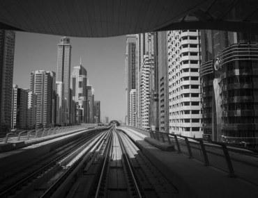 Popular property renting areas of Dubai: Dubai metro tracks with buildings in background