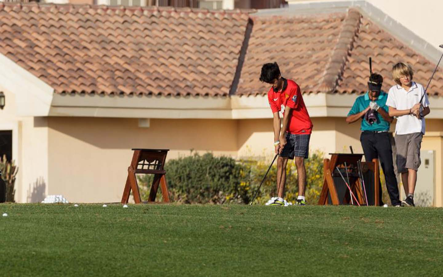 A child is playing golf