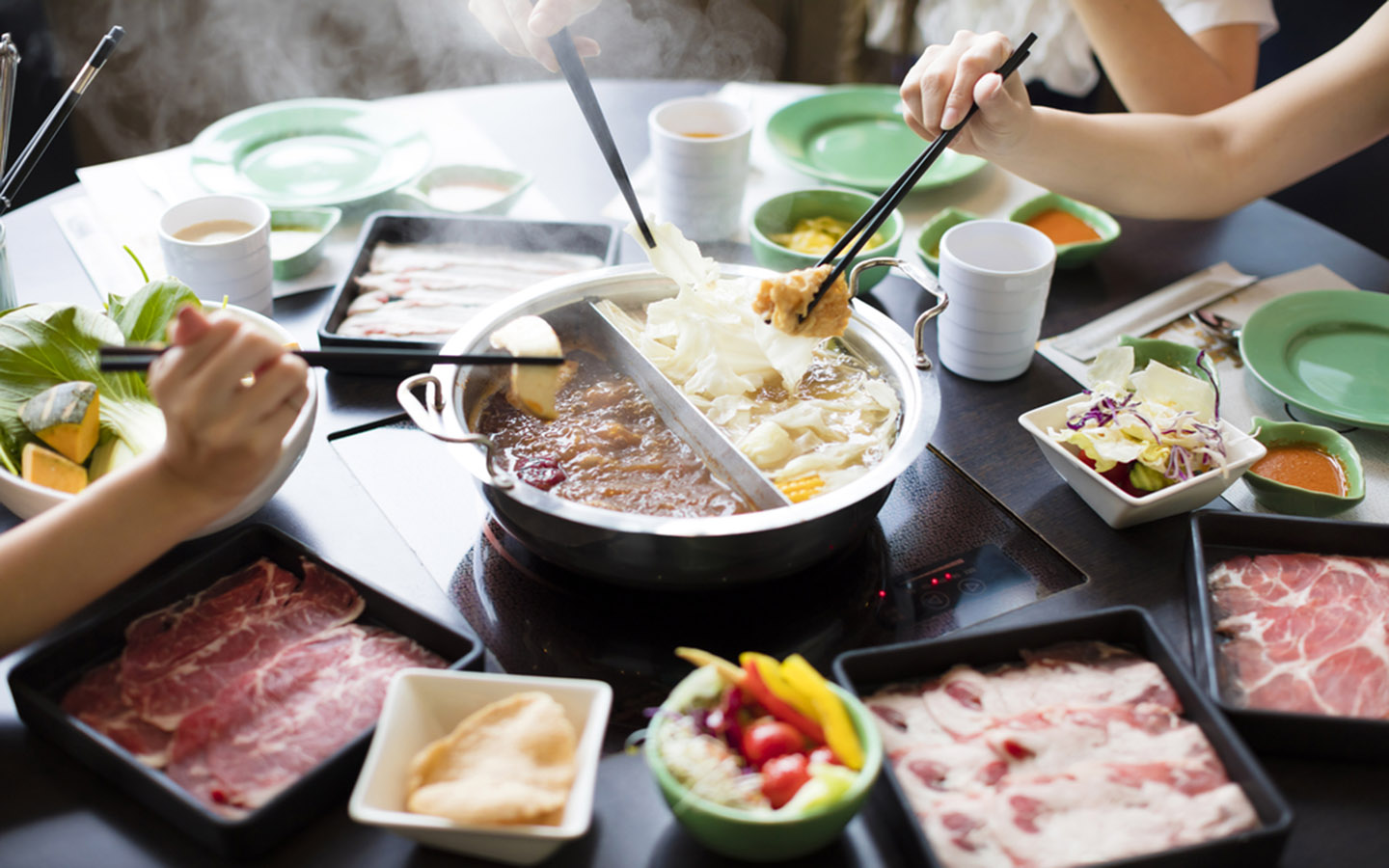 People are enjoying hot pot in a restaurant in Dubai