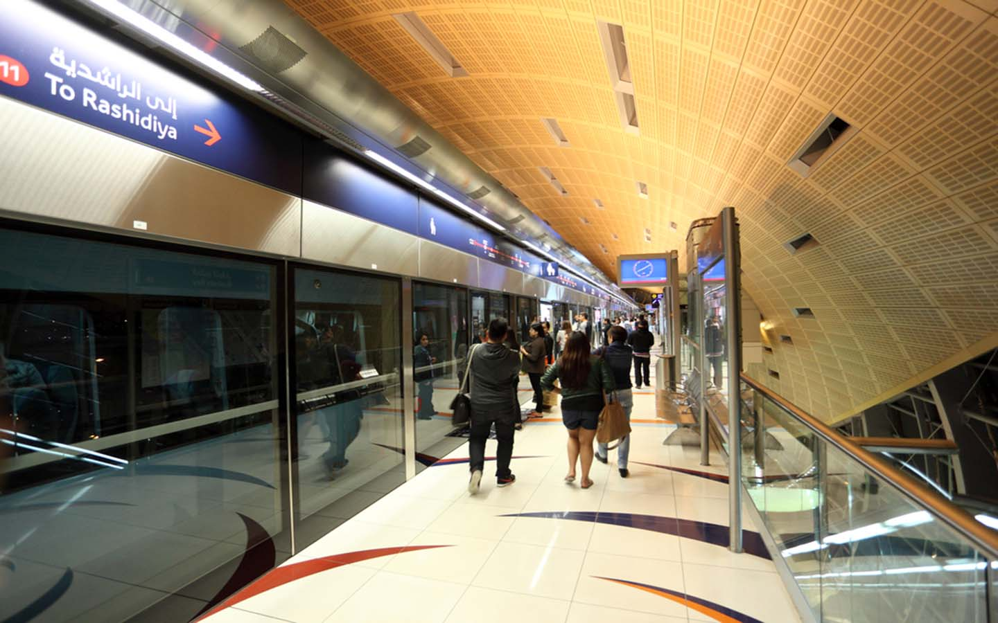 People moving in and around Dubai metro station