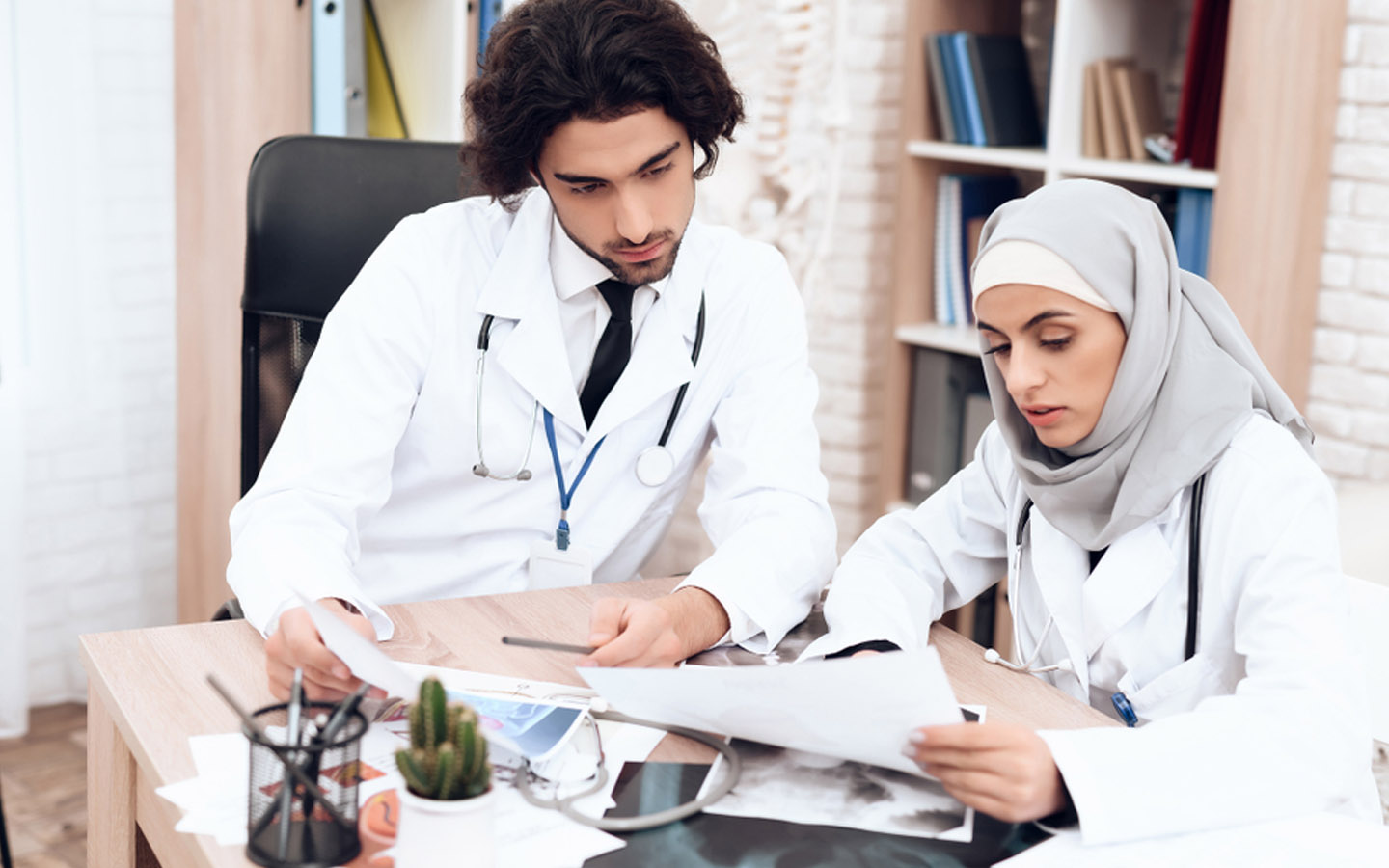 female and male doctors discussing medical report