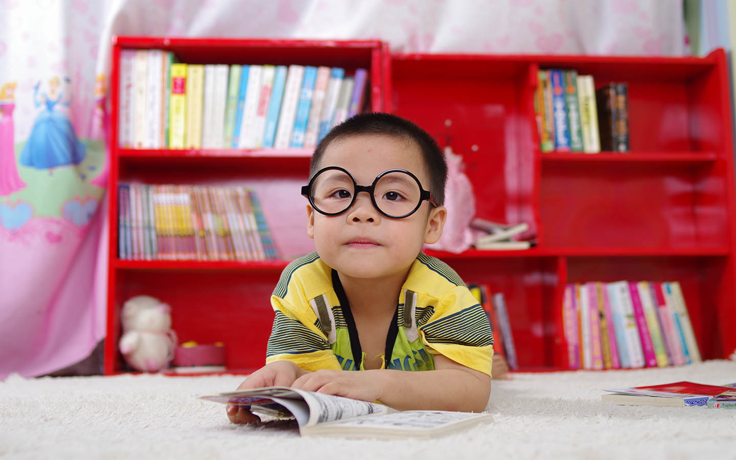 Kid posing in a classroom at a nursery