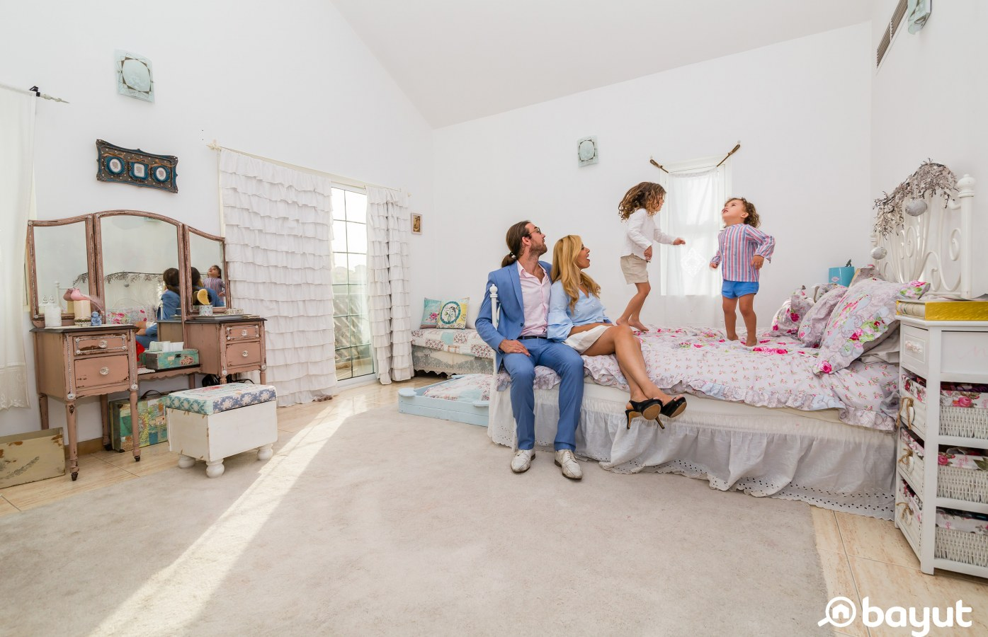 At home with Muby Astruc, the boys jumping on the bed