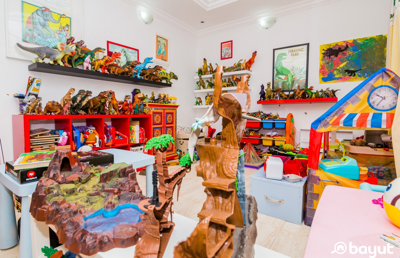 The children's hard play area, filled with dinosaurs, cars and toys