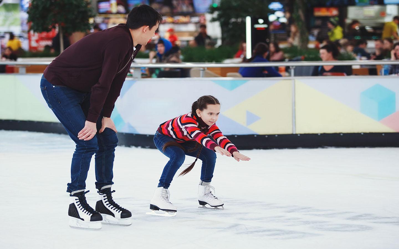 little girl learning ice skating