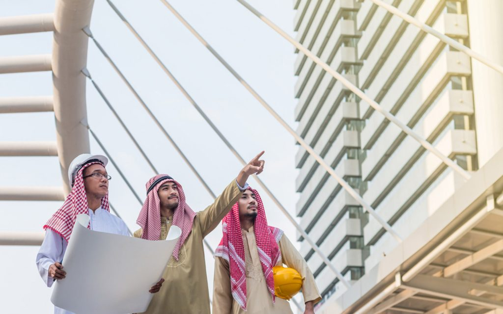 City planners in the UAE overlooking  a building construction