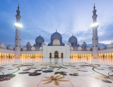 Sheikh Zayed Mosque in Abu Dhabi is the key centre of worship in the UAE; Cover Image of Bayut's: These are the Cheapest Places to Rent or Buy in Abu Dhab in 2017 report