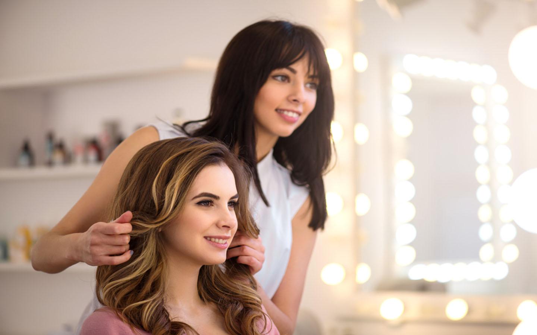 stylist styling woman's hair