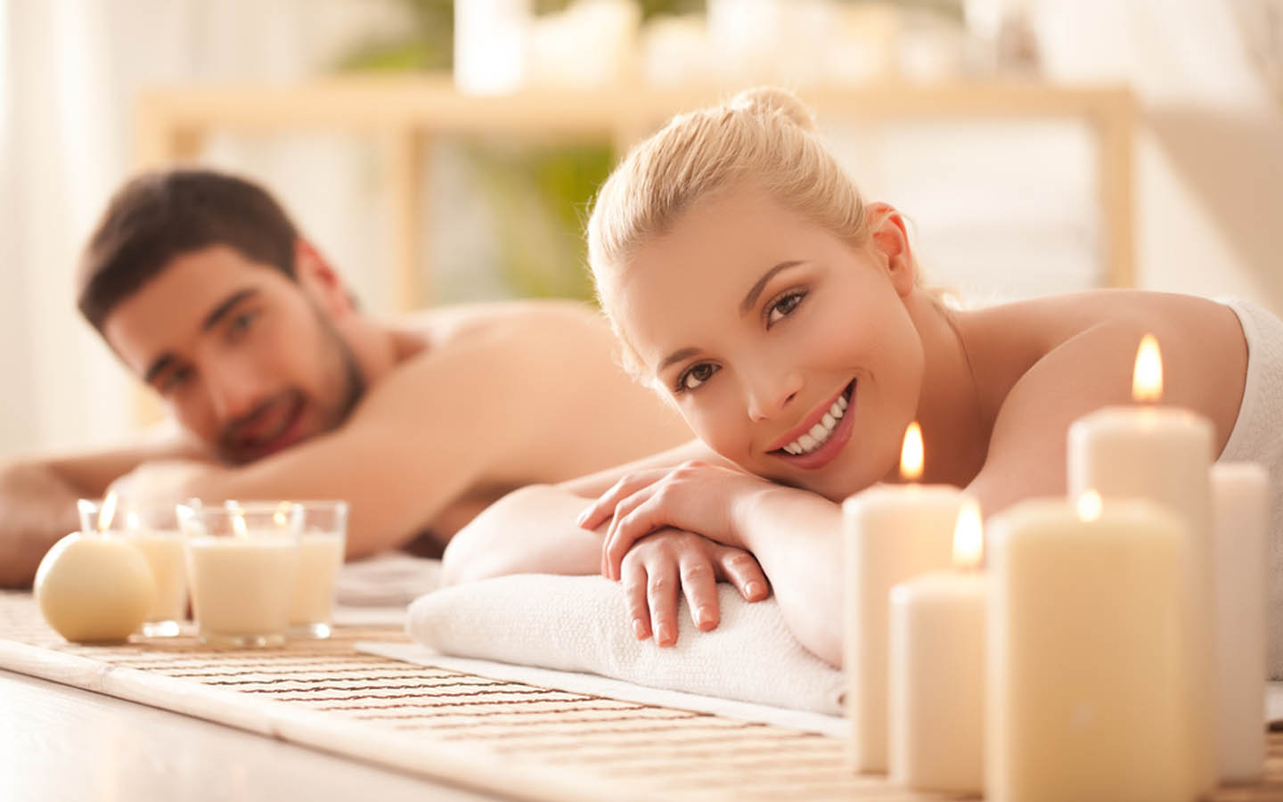 couple enjoying a relaxing therapy at a spa
