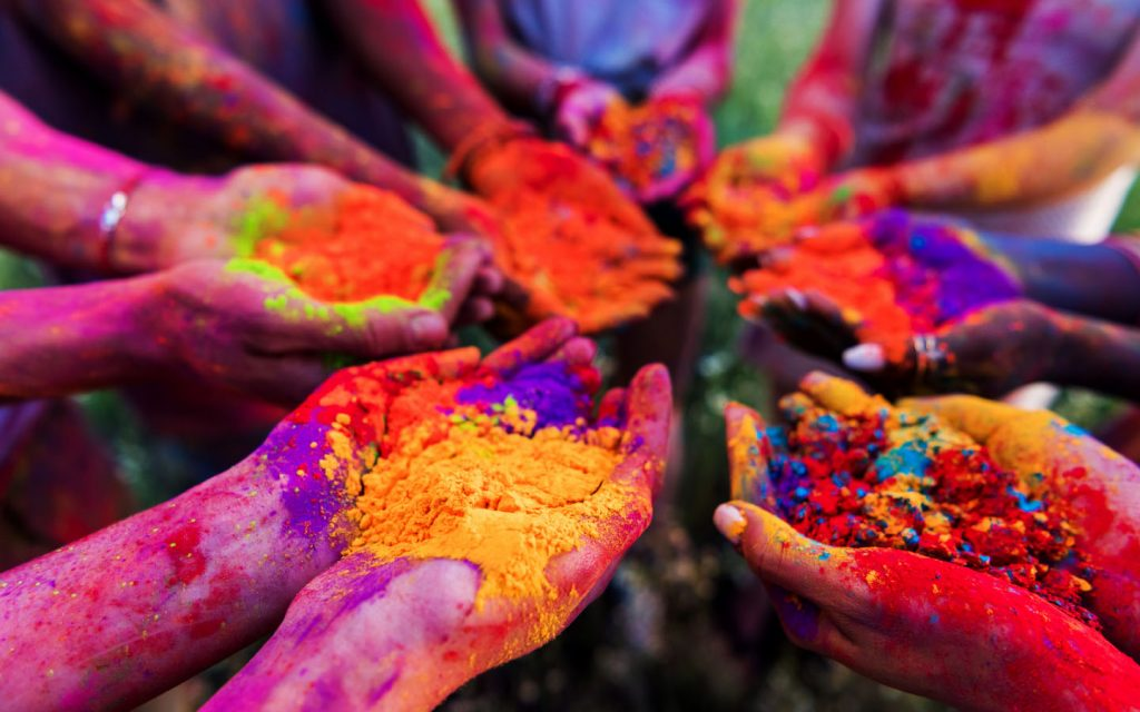 hands full of colourful powders