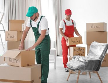 Two men from one of the packers and movers in Al Quwain working