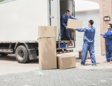 Men loading items in a truck