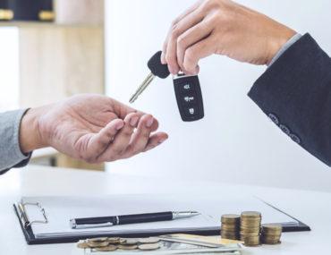 man is selling a financed car in Dubai