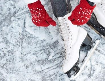 girl wearing ice skates on ice rink
