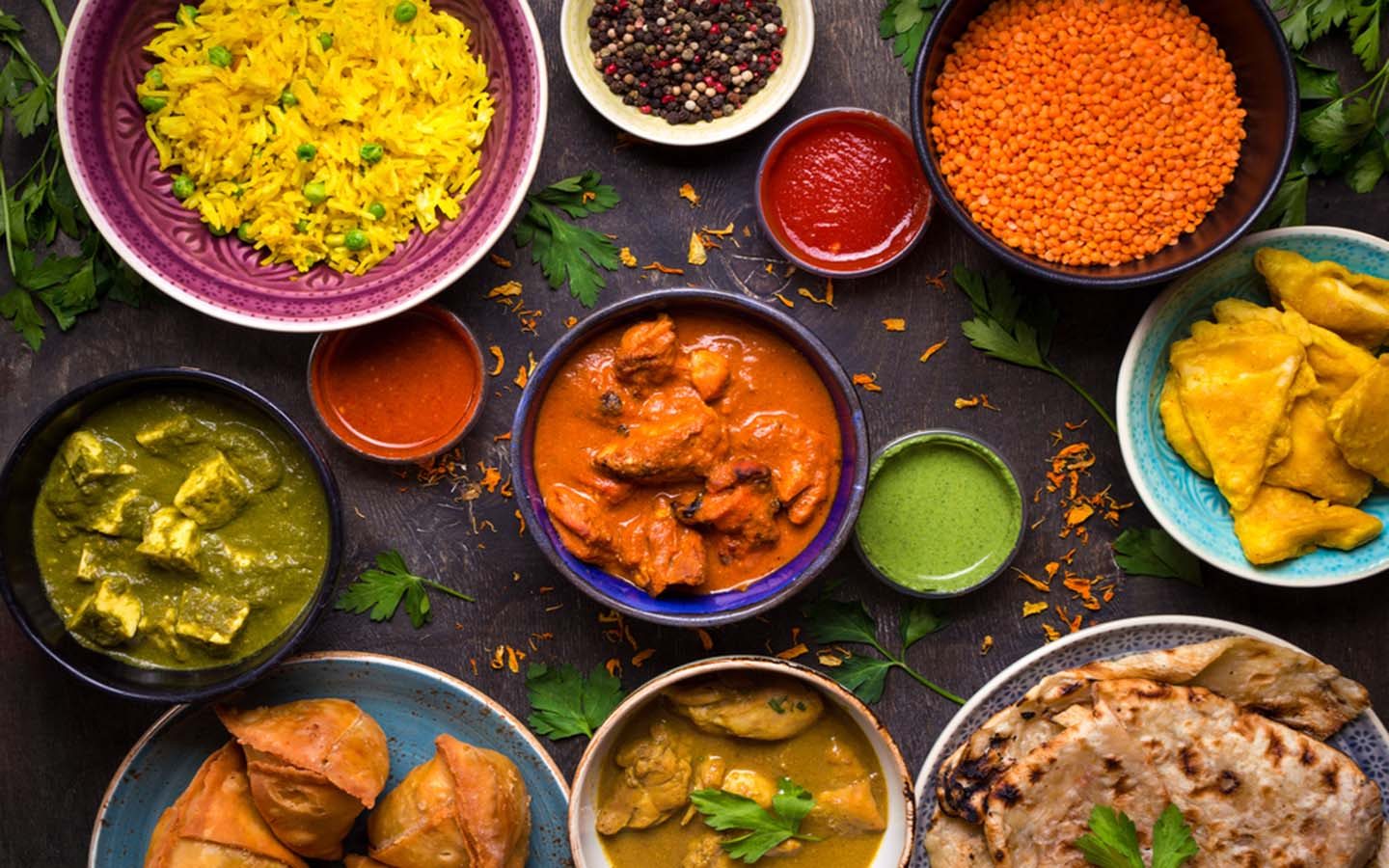 indian curries, rice dish and condiments