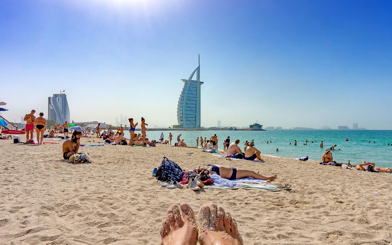 People lying on the beach and enjoying beautiful views