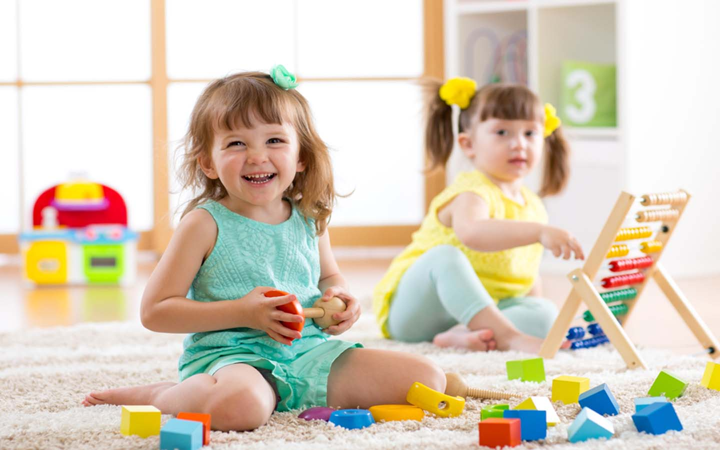 Kids playing together at a playschool
