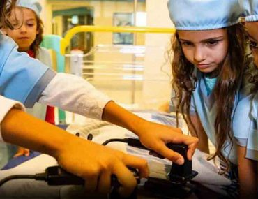 kids working at a make-believe hospital