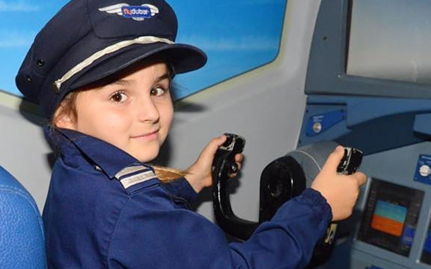 A kid flying a simulator