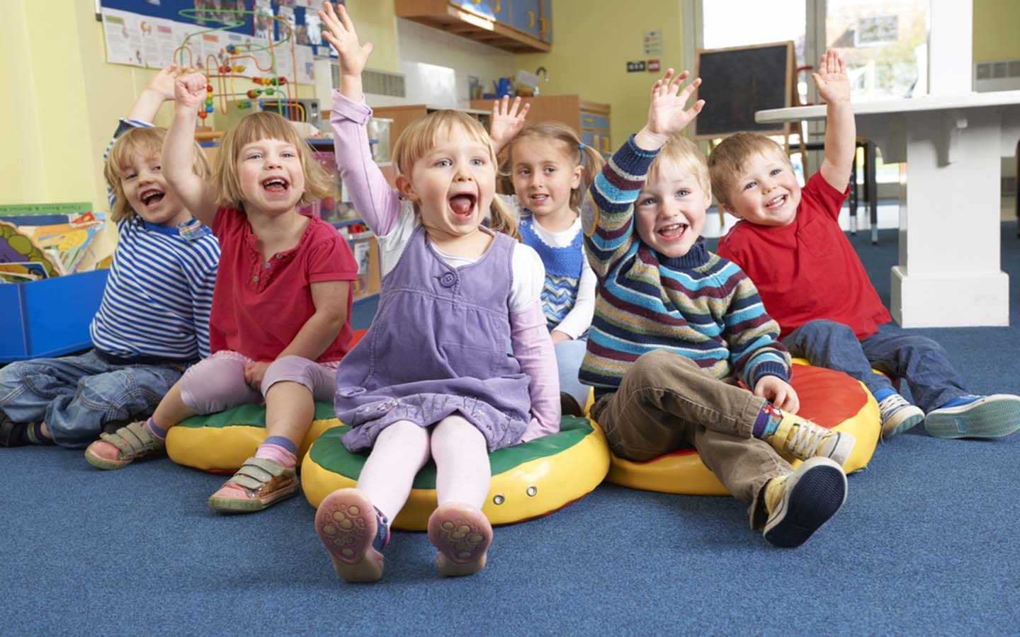 Kids participating in a group discussion at a preschool