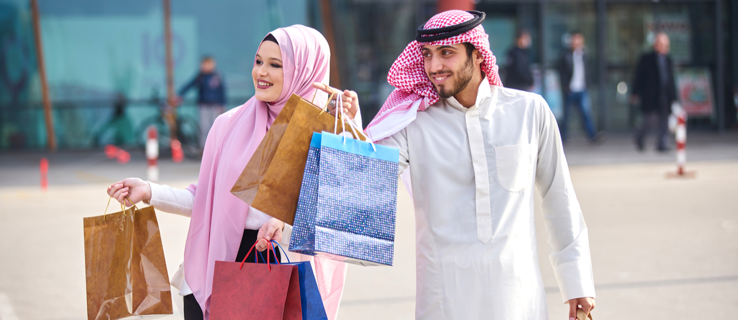 Couple in front of the shopping malls in Ajman