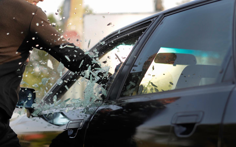 man vandalising car