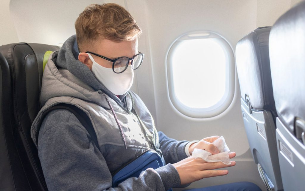 man with a mask on flight