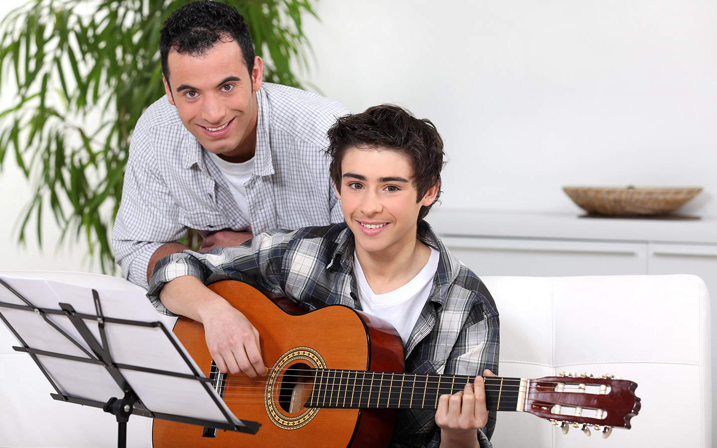 Young man with his guitar teacher