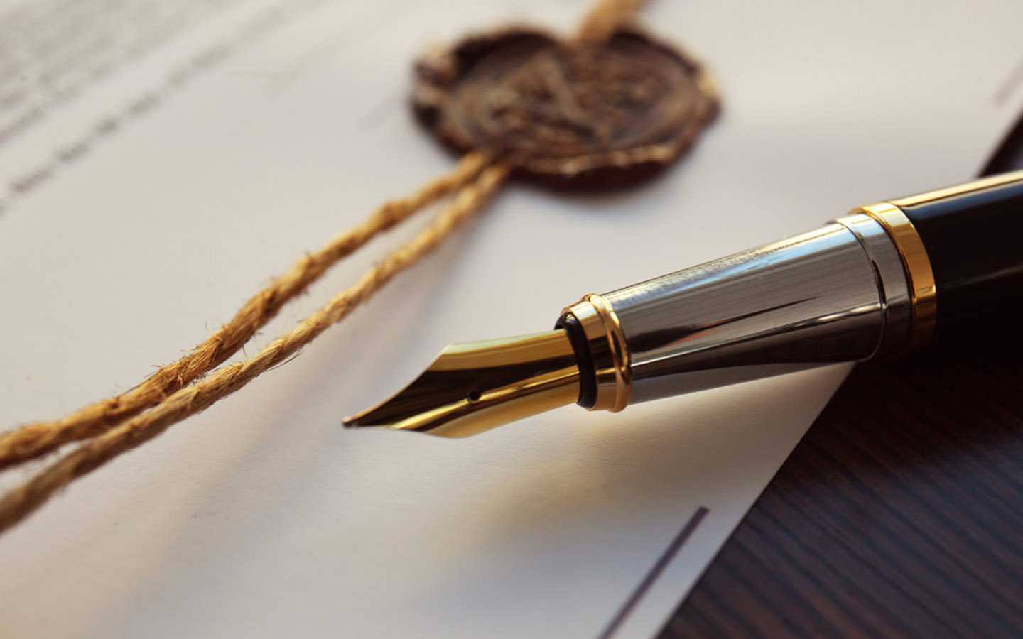 pen and a seal on a document