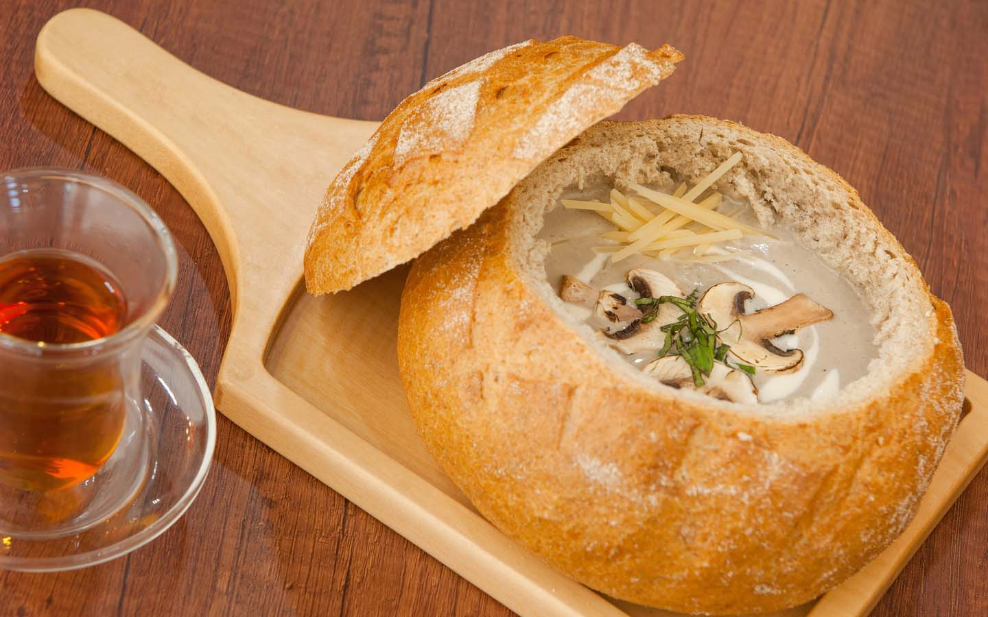 Try out the mushroom and pumpkin soup at First Clique that comes in a bread bowl