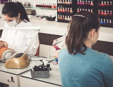Girls offering nail care services to their clients