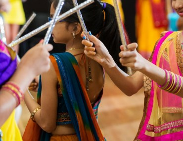 Girls dancing with dandiya sticks during Navratri