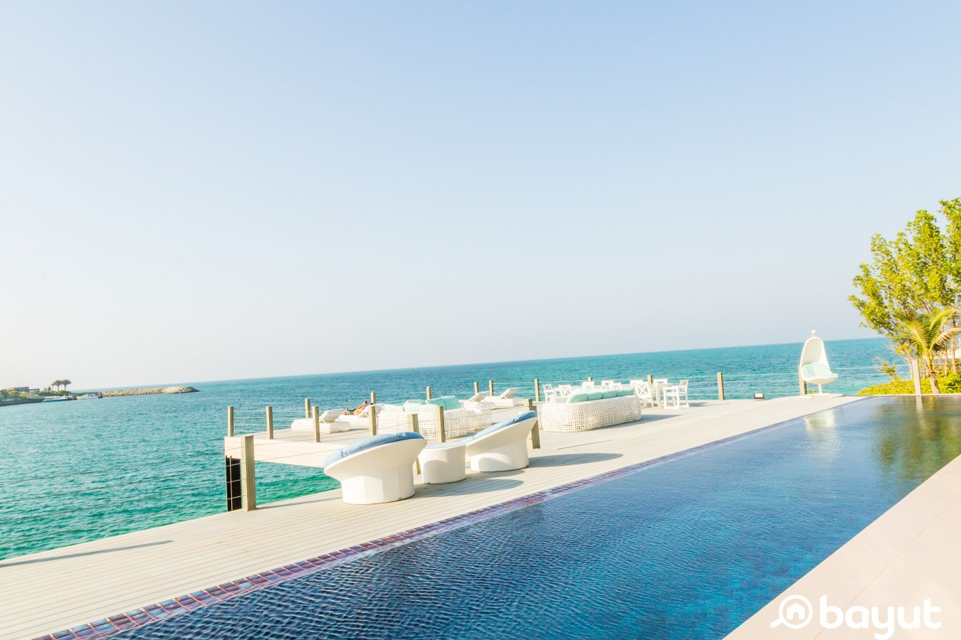 an infinity pool outside of a private villa for sale in nurai island abu dhabi