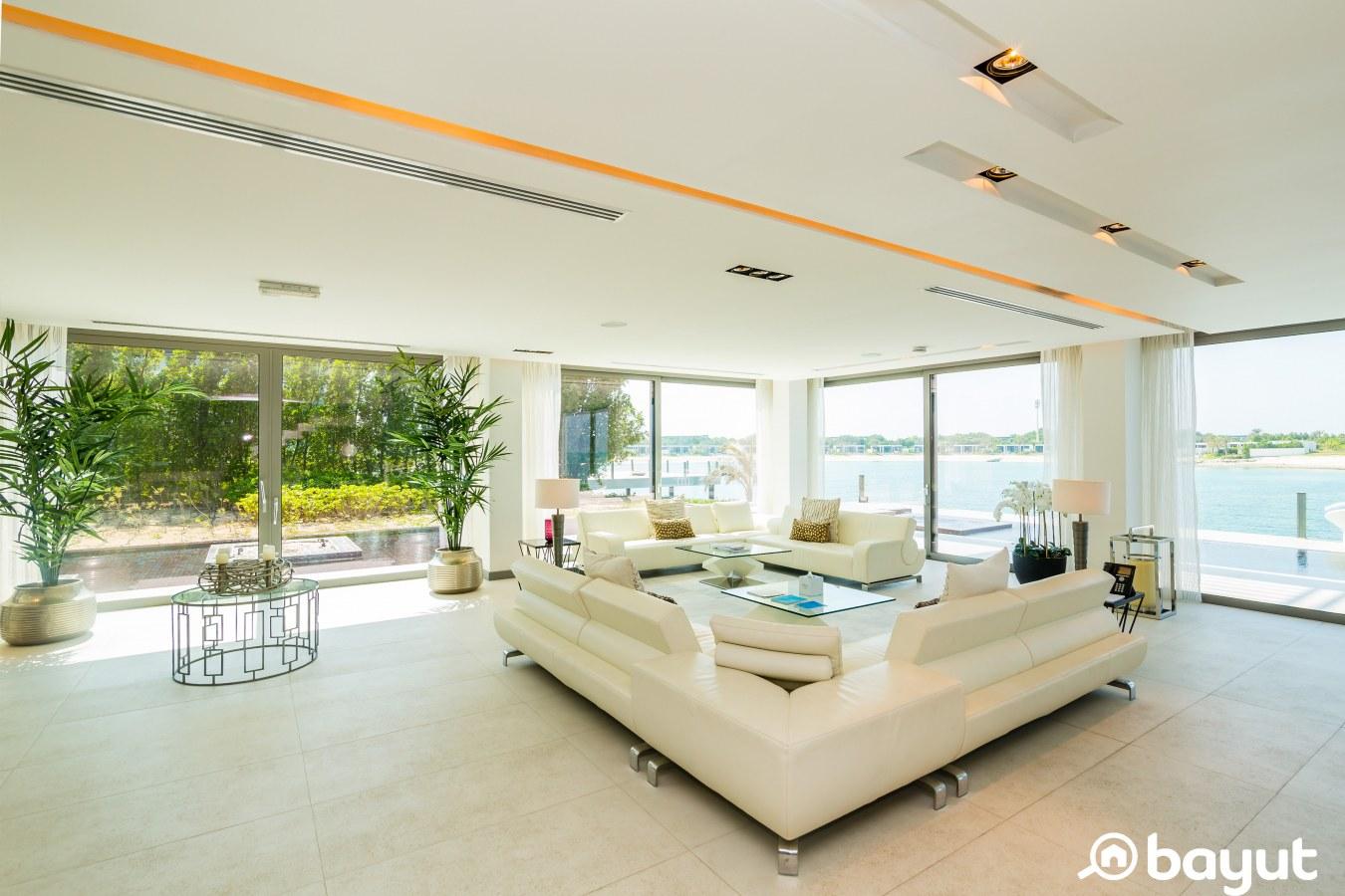 the living room white views of the Arabian Gulf and white furniture in a villa in Nurai Island Abu Dhabi