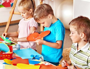 Children showcasing their artistic skills at a nursery in JVC