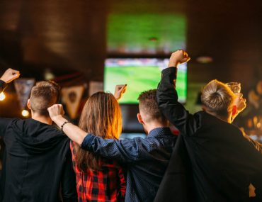 people cheering in sports bar