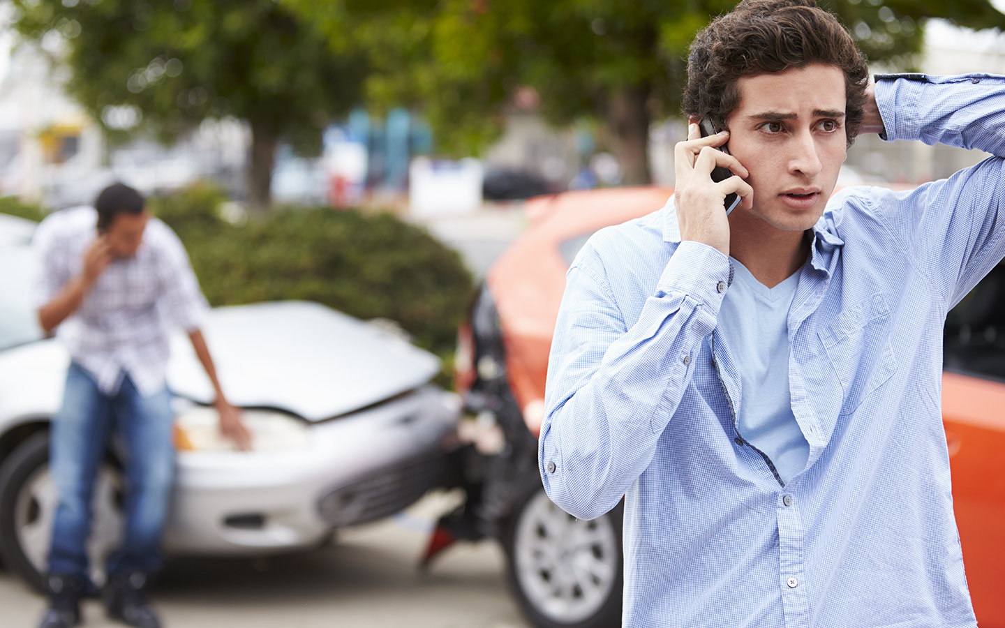 Person calling to report accident to Dubai Police